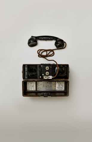 black telephone on white surface